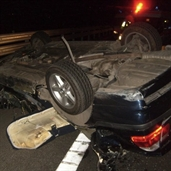 BMW hits 18 wheeler trailer bumper and rolled over