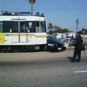 Train crashed police car in california