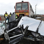 Train hits fiat at a high speed, and smashed it
