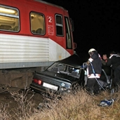 Ford crashed by train