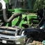 Chevy silverado smashed by field harvester